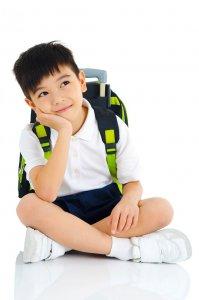 Asian boy with school bag