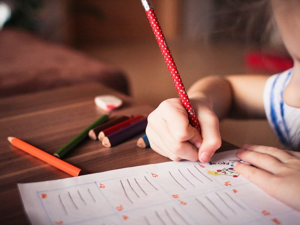 Child writing on a desk