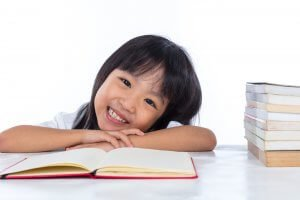 Primary student studying happily