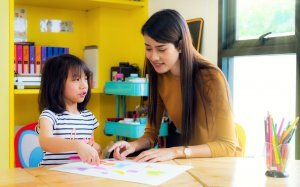 Teacher teaching a child