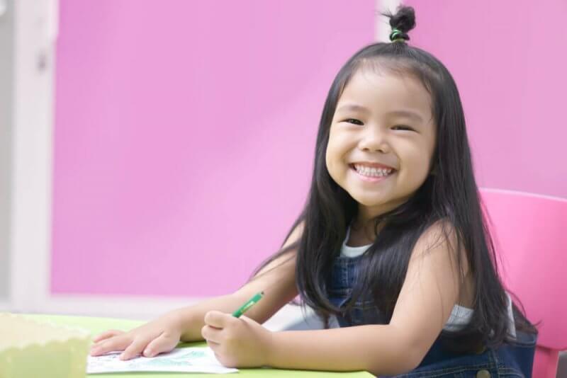 Pre School little girl smiling brightly