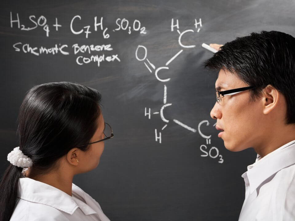 students analysing chemistry equation