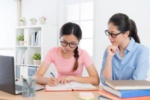 Female student having tuition