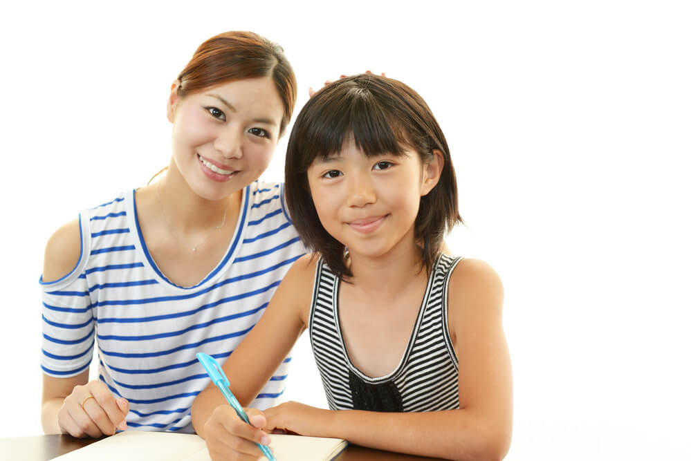 Asian girl having tuition