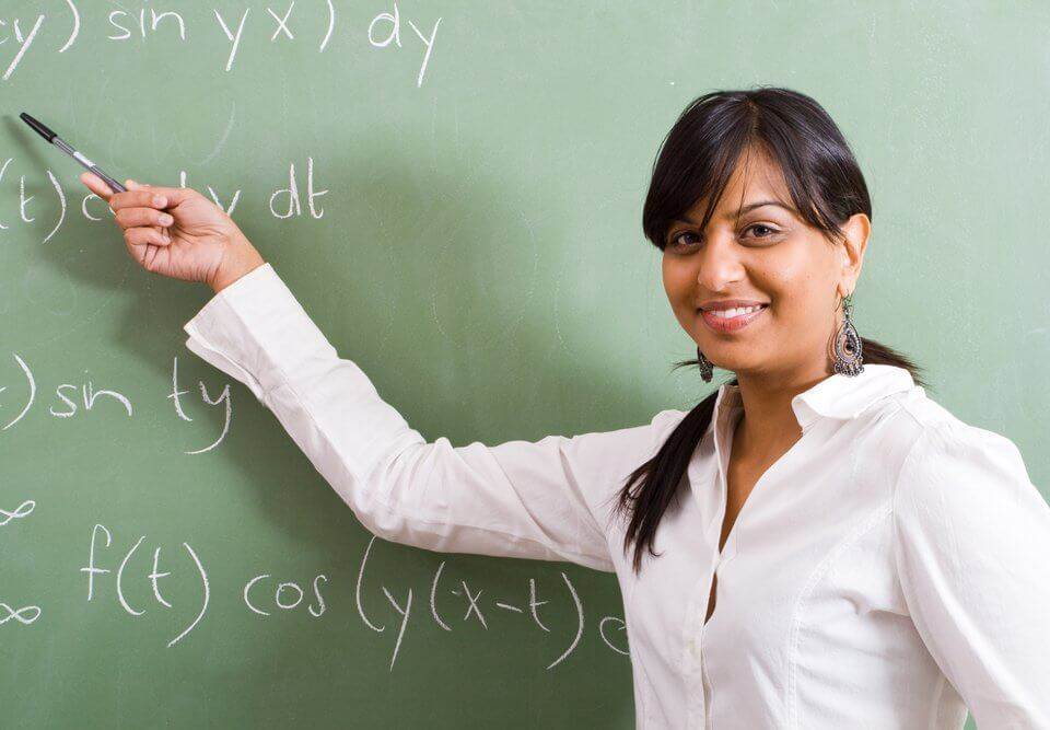 young pretty female math teacher in classroom