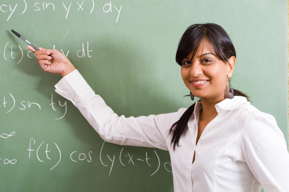 young pretty female math teacher in classroom