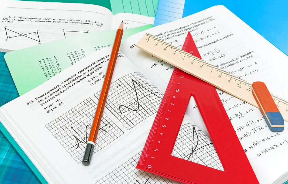 Mathematics textbook, notebook, pencil and ruler