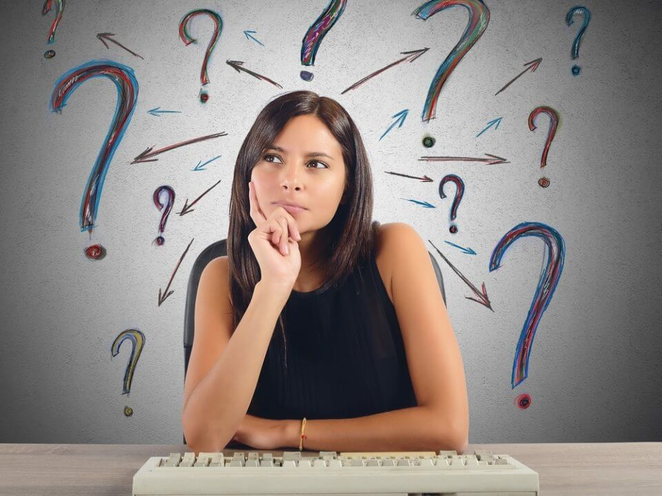 Woman considering with question marks