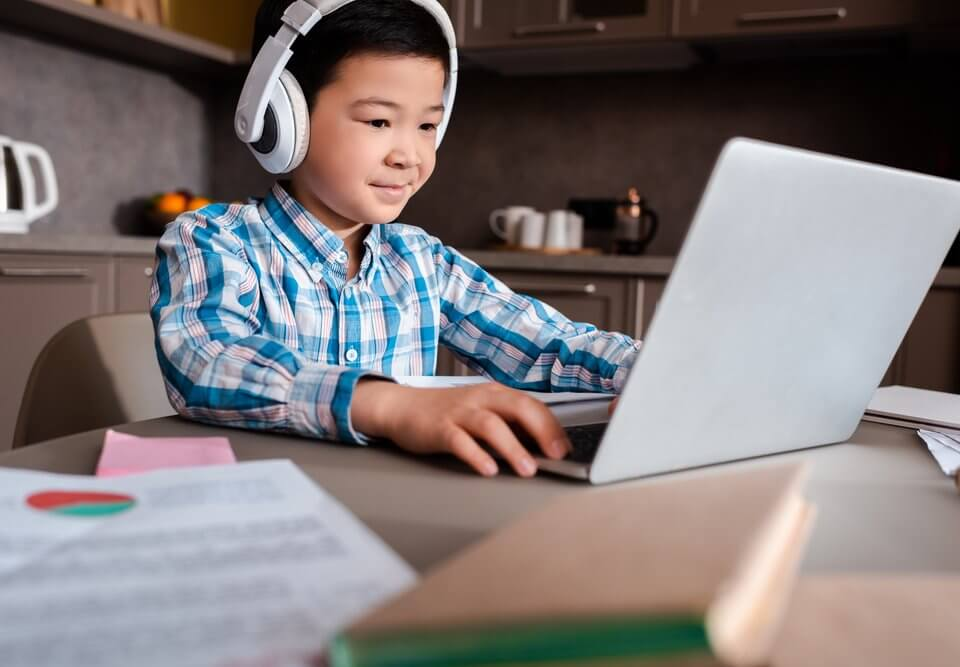 Asian boy online studying