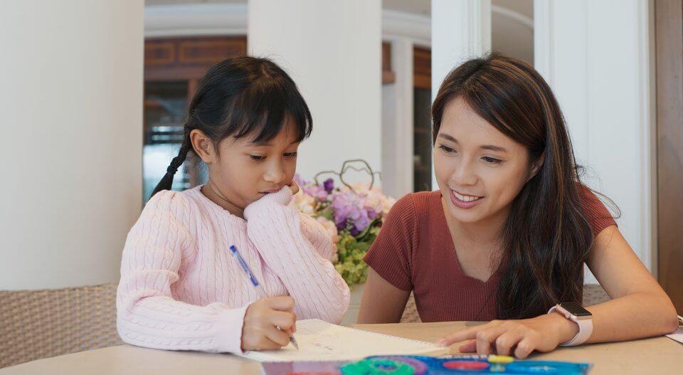 Tutor teaching little girl